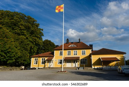 "September 11, 2016: Old Church School next to Church of Salem, the sun shines on an autumn day. Flag belonging to the religious community ""Svenska kyrkan"" (The Swedish Church)"
