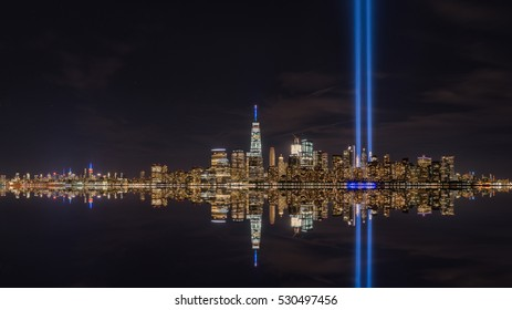 September 11th memorial lights water reflections from Liberty State Park, NJ.