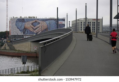 SEPTEMBER 12, 2013 - BERLIN: a huge election poster showing the hands of Chancellor Angela Merkel near the main station of Berlin.