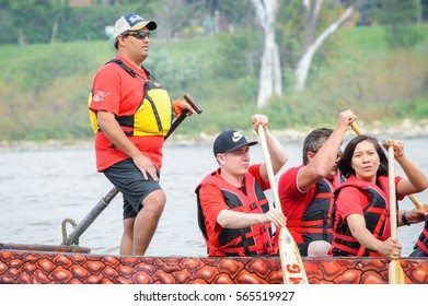 September 12, 2015  Red river in Winnipeg, MB, Canada  Team building activity during rowing dragon boat race