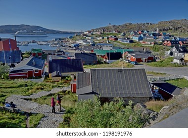 September 12, 2018, Qaqortoq, Greenland. The Village Of Qaqortoq, Greenland Is Seen With A Visiting Cruise Ship In Its Harbor.