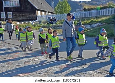 September 12, 2018, Qaqortoq,  A Teacher Leads Her Group Of Children On A Field Trip Near The Center Of Qaqortoq, Greenland.