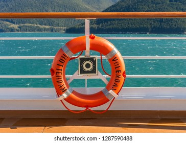 September 14, 2018 - Inside Passage, Alaska: Bright orange lifering life saving equipment stored on railing of The Volendam cruise ship.