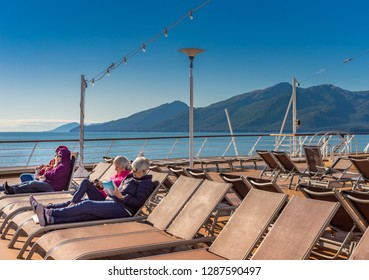 September 14, 2018 - Inside Passage, Alaska: Passengers on The Volendam ship relaxing in the sun on the Lido deck.