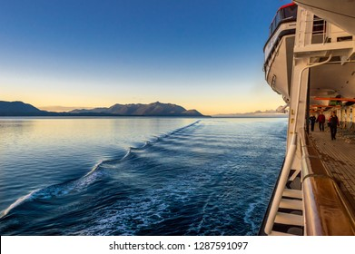 September 14, 2018 - Inside Passage, Alaska: Cruise ship passengers catching early morning exercise outdoors at sunrise on the Holland America ship The Volendam.