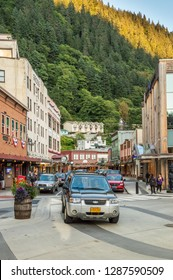 September 14, 2018 - Juneau, Alaska: Vehicles and tourist pedestrians on busy Front Street in historic downtown Juneau.