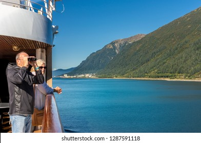 September 14, 2018 - Juneau, Alaska: Cruise ship passengers on board The Volendam enjoying the view while approaching Juneau along The Gastineau Channel.