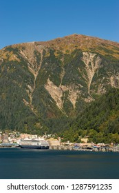 September 14, 2018 - Juneau, Alaska: Docks at entrance to city harbor with cruise ship The Zaandam in port.