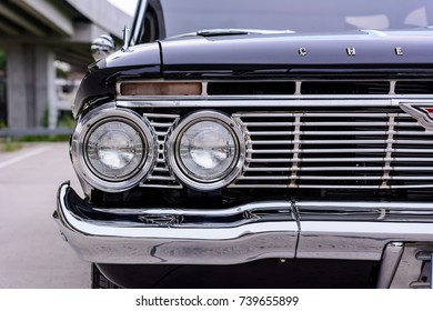 September 14,2017-Bangkok,Thailand-Detail of the front section of a 1961 Chevrolet Impala 4-Door Sedan car including the front lights
