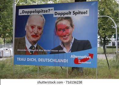 "SEPTEMBER 15, 2017 - BERLIN: a vandalized  election poster of the German populist party ""AfD"" with its leaders Alexander Gauland and Alice Weidel to the upcoming general elections, Berlin."