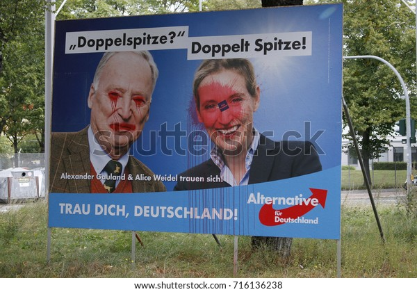 """SEPTEMBER 15, 2017 - BERLIN: a vandalized  election poster of the German populist party """"AfD"""" with its leaders Alexander Gauland and Alice Weidel to the upcoming general elections, Berlin."""
