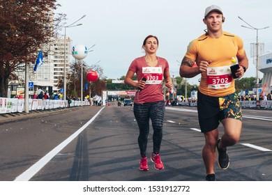 September 15, 2018 Minsk Belarus Half Marathon Minsk 2019 Man and woman run half marathon on city road