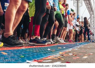 September 15, 2018 Minsk Belarus Half Marathon Minsk 2019 Men and women marathon runners stand in front of the half marathon start line in the city