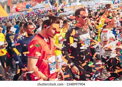 September 15, 2018 Minsk Belarus Half Marathon Minsk 2019 Athletes men and women run on the road half marathon. Confetti flies in the air. Festive mood.