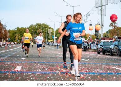 September 15, 2018 Minsk Belarus Half Marathon Minsk 2019 Woman with man run through the finish line