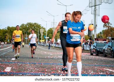 September 15, 2018 Minsk Belarus Half Marathon Minsk 2019 Tired woman with a man running through the finish line