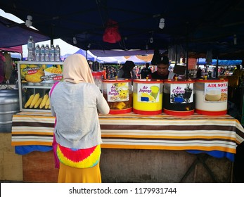 September 15, 2018 - Pantai Remis, MALAYSIA. Hawkers selling drinking water to customers in local beach in Malaysia.
