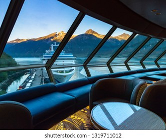 September 15, 2018 - Skagway, AK:  Sunrise view of ship in port from inside The Crow's Nest aboard The Volendam.