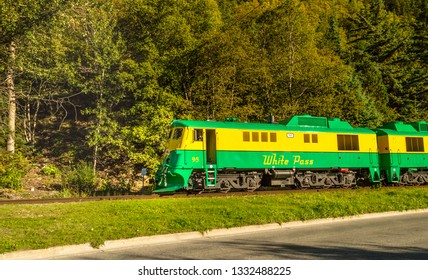 September 15, 2018 - Skagway, AK: White Pass Railway train travelling alongside Congress Way, near Dewey Creek.