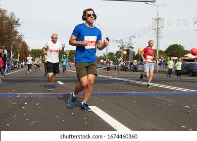 September 15, 2019 Minsk Belarus Half Marathon Minsk 2019 Participants in glasses and headphones cross the finish line of the marathon