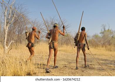 September 16, 2008. Bushmen (San or Saan people) walking on the Kalahari desert in Ghanzi, Botswana.