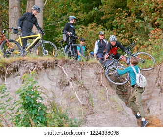 September 16, 2018, Kaliningrad region, Russia, tourists help each other, cyclists and steep hill