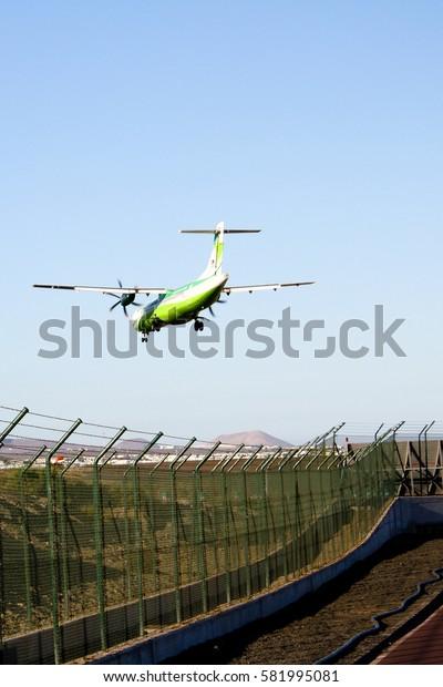 September 16th, 2012, Arrecife, Lanzarote, Spain - Binter Canarias airplane aproaches for landing at the Lanzarote Airport.