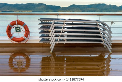 September 17, 2018 - Clarence Strait, AK: Life ring and stacked damp loungers, early morning on cruise ship The Volendam