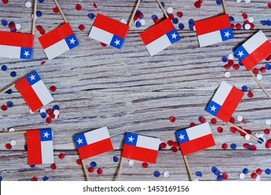 September 18, happy independence day of Chile. memorial day for independence. the concept of patriotism. mini flags with confetti on white wooden background