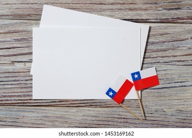 September 18, happy independence day of Chile. memorial day for independence. the concept of patriotism. flags with white sheets of paper on a wooden background