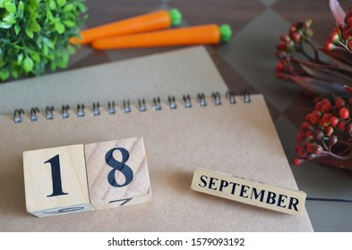 September 18, Save the date with number cube design for background.