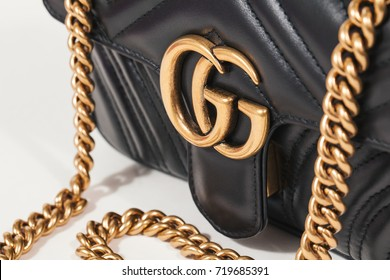 september 19, 2017,seoul in soth repubilc korea, black gucci bag with goden chain on white backgrounds, gucci is famous luxury fashion brand in global