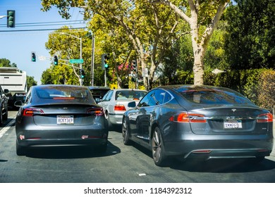 September 19, 2018 Palo Alto / CA / USA - Two Tesla cars (Model S and Model 3) driving on the streets of Silicon Valley, south San Francisco bay area