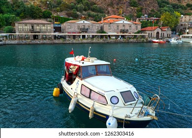 September 19,2018- Assos, Canakkale, Turkey. View of the old stone houses  and fishing boat.