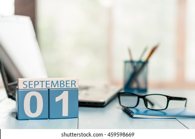 September 1st. Day 1 of month, Back to school concept. Calendar on teacher or student workplace background. Autumn time. Empty space for text