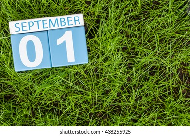 September 1st. Image of september 1 color calendar on green lrass lawn background. Autumn day. Empty space for text. Back to school time