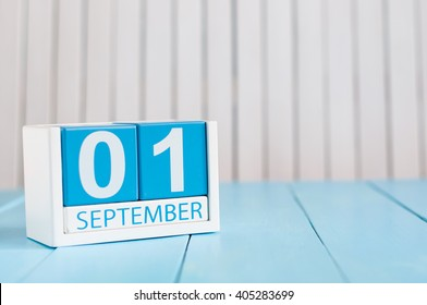 September 1st. Image of september 1 wooden color calendar on blue background. Autumn day. Empty space for text. Back to school time