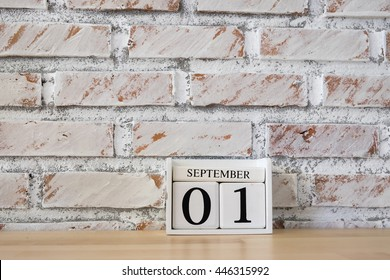 September 1st. Image of september 1 wooden color calendar white brick wall background.  Empty space for text.