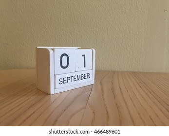 September 1st.September 1 white wooden calendar on wood background.Copyspace for text.Autumn day.