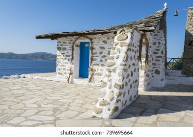 September  20,  2017,Church on cliff of Tsougrias, Skiathos, Greece: Church on cliff of Tsougrias island in the middle of sea on sunny day, near Skiathos island in Greece
