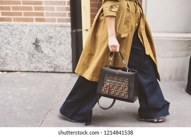 September 20, 2018: Milan, Italy - Street style concept during Milan Fashion Week, girl with Fendi bag  - PFWSS19