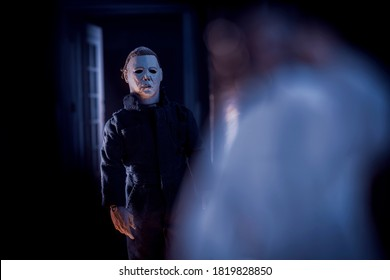 SEPTEMBER 20 2020: recreation of a scene from John Carpenter's Halloween, Michael Myers stalking  Annie Brackett - Neca action figure