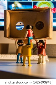 SEPTEMBER 2015: Playmobil playing with google cardboard 3D glasses