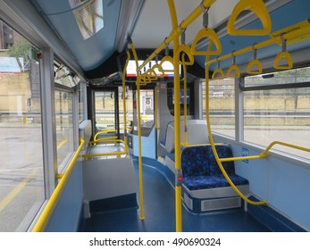 September 2016, The inside of an empty single-decker, all electric London bus - the shot looks down from the middle of the bus to the front entrance
