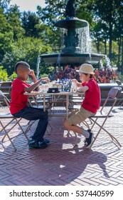 September of 2016. New York City. Central Park.Two boys playing chess in a tournament.