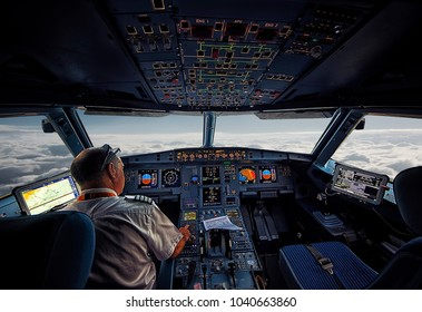 September 2016 - On board - Airline pilot at work in the cockpit. Airbus A320 cockpit