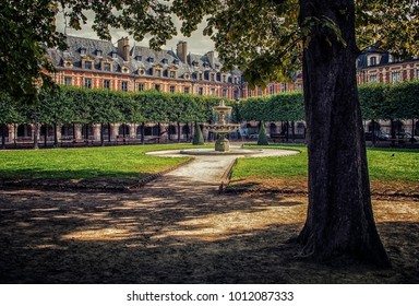 "september 2016 - Paris, France - ""Place des vosges"" square in the Marais district, Paris"