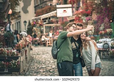 SEPTEMBER 2017, BELGRADE SERBIA: Skadarlija street, foreign tourists taking a selfie picture, three friends capturing their adventure in Belgrade