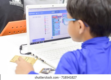 September, 2017. Phil the young Asian boy is focusing on his digital coding class in Thailand.