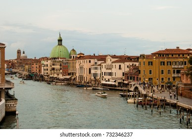 September, 2017 Venice.  A view of the great canal with boats and typical houses with a cloudy sky.